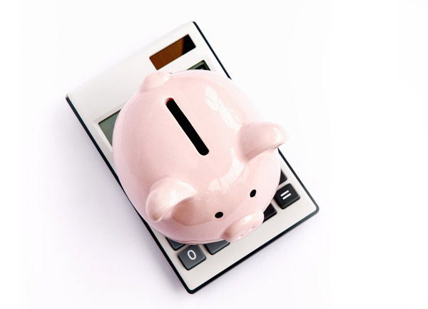 Piggy bank stacked on top of a calculator